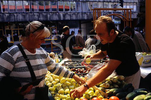 Sarajevo, Bosnia and Herzegovina. People buying/selling vegetables on the market; tomatoes; pepper; cucumber.