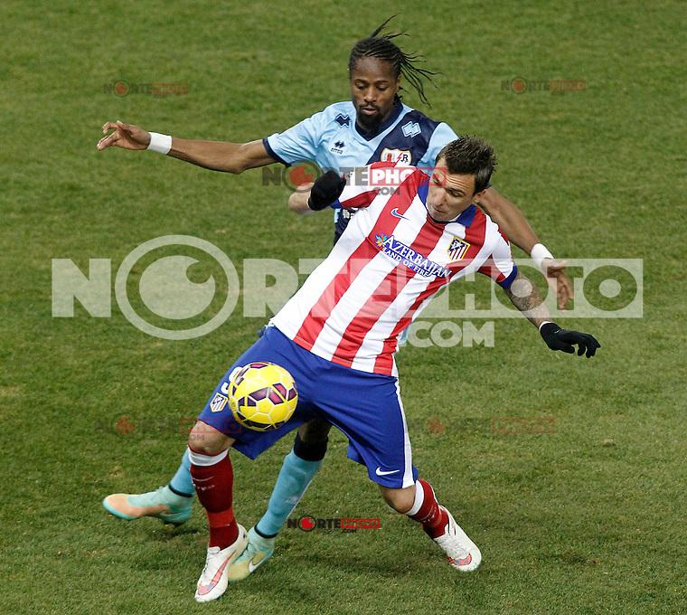 Atletico de Madrid's Mario Mandzukic (f) and Rayo Vallecano's Abdoulaye Ba during La Liga match.January 24,2015. (ALTERPHOTOS/Acero) /NortePhoto<br /> NortePhoto.com