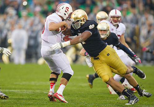 October 13, 2012:  Notre Dame defensive end Stephon Tuitt (7) sacks Stanford quarterback Josh Nunes (6) during NCAA Football game action between the Notre Dame Fighting Irish and the Stanford Cardinal at Notre Dame Stadium in South Bend, Indiana.  Notre Dame defeated Stanford 20-13.