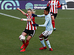 Olivia Ferguson of Sheffield Utd tackles Elisha N'Dow of Aston Villa during the The FA Women's Championship match at the Proact Stadium, Chesterfield. Picture date: 12th January 2020. Picture credit should read: Simon Bellis/Sportimage