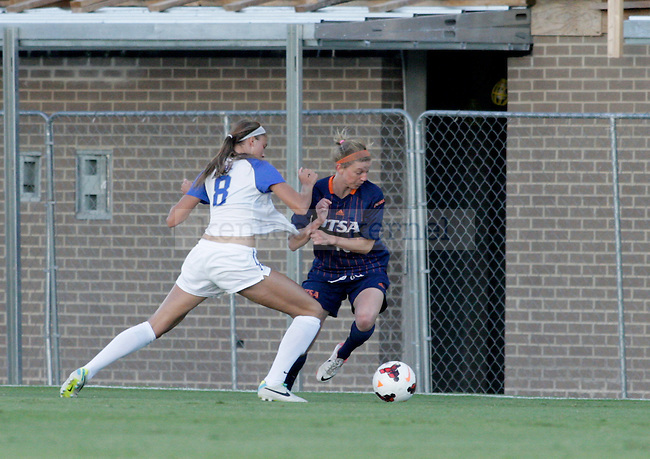Sophomore Kelli Hubly has her shirt grabbed while she tries to take the ball away from UTSA during the women's soccer game against the University of Texas San Antonio September 13, 2013 at the UK Soccer Complex in Lexington, Ky.