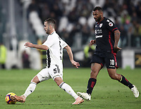 Calcio, Serie A: Juventus - Caglairi, Turin, Allianz Stadium, November 3, 2018.<br /> Juventus' Miralem Pjanic (l) in action with Cagiari's Joao Pedro (r) during the Italian Serie A football match between Juventus and Cagliari at Torino's Allianz stadium, November 3, 2018.<br /> UPDATE IMAGES PRESS/Isabella Bonotto