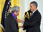 United States President Barack Obama presents the 2012 National Medal of Arts to Allen Toussaint during a ceremony in the East Room of the White House in Washington, D.C.  on Wednesday, July 10, 2013.<br /> Credit: Ron Sachs / CNP