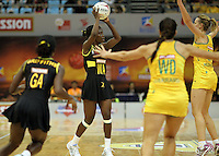 09.07.2011 Jamaica's Kimone Tulloch in action during the netball match between Jamaica and Australia at the Mission Foods World Netball Championship 2011 held at the Singapore Indoor Stadium in Singapore . Mandatory Photo Credit ©Michael Bradley.