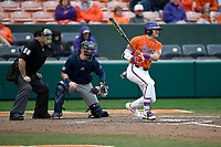 Left fielder Bo Majkowski (16) of the Clemson Tigers bats in a game against the South Alabama Jaguars on Opening Day, Friday, February 15, 2019, at Doug Kingsmore Stadium in Clemson, South Carolina. The catcher is Carter Perkins and the umpire is Craig Barron. Clemson won, 6-2. (Tom Priddy/Four Seam Images)