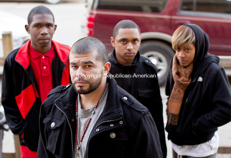 Waterbury, CT- 04, December 2010-121610CM03 (Foreground) Anthony Schovanec stands outside his Willow Street home in Waterbury.  Behind him are Kentrell Morey, 16, Morris Morey, 17, and  Lintaisha Williams, 17 (right).  The group allege that they were beaten by Waterbury Police Officers after accidentally pulling into a driveway of a police officers home.   Christopher Massa Republican-American