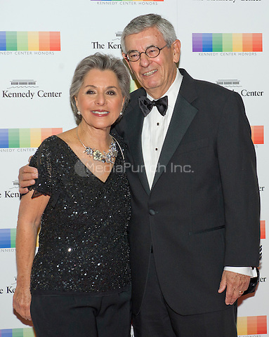 United States Senator Barbara Boxer (Democrat of California) and her husband, Stewart, arrive for the formal Artist's Dinner honoring the recipients of the 38th Annual Kennedy Center Honors hosted by United States Secretary of State John F. Kerry at the U.S. Department of State in Washington, D.C. on Saturday, December 5, 2015. The 2015 honorees are: singer-songwriter Carole King, filmmaker George Lucas, actress and singer Rita Moreno, conductor Seiji Ozawa, and actress and Broadway star Cicely Tyson.<br /> Credit: Ron Sachs / Pool via CNP/MediaPunch