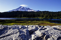Scenic view of Mt. Rainier, lake meadow and rocks in Washington state