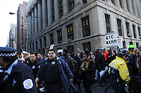 Police officers and protesters calling on Chicago Mayor Rahm Emanuel to resign stage a sit in in front of City Hall at the intersection of Washington and Clark Street in the Loop in Chicago, Illinois on December 9, 2015.  Emanuel offered a historic apology for the police killing of Laquan McDonald and police brutality and racial profiling generally -- without using those words -- in front of the City Council in the morning.