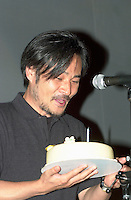 KIYOSHI KUROSAWA at Fantasia Festival<br /> <br /> <br /> Japanese film maker KIYOSHI KUROSAWA receive a birthday cake while  on stage to present his movie S…ANCE at Fantasia Film Festival, July 18 2001 in Montreal, CANADA <br /> <br /> Born in  1955 in  Kobe, He allready made about 30 movies of all kinds  :  horror, erotism, drama, action, Yakuza gangsters. The most famous beeing :<br /> Cure (1997), Barren Illusions (1999) and  Charisma (1999). He is one of the most productive and important film maker in contemporary Japanese cinema.<br /> <br /> Photo by Pierre Roussel / Getty Images News Service<br /> <br /> NOTE :  Nikon D-1 JPEG, opened with QUIMAGE ICC profile, saved as Adobe RG 1998