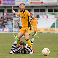 Jorge Grant of Notts County falls under a challenge from Dan Butler of Newport County during the Sky Bet League 2 match between Newport County and Notts County at Rodney Parade, Newport, Wales on 6 May 2017. Photo by Mark  Hawkins / PRiME Media Images.