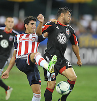 Carlos Ruiz (20) of D.C. United goes against Nestor Vidrio (2) of C.D. Guadalajara. C.D.Guadalajara tied D.C. United 1-1 during and international friendly, at RFK Stadium, Friday July 12, 2013.