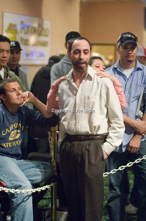 Barry Greenstein shares a moment during play with his son, Joe Seebok, and his wife.