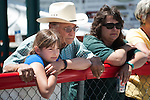 Emma Modrell, 11, and her grandfather Lawrence Lopes watch Aubrey Modell, 17, compete during the California Youth Shotgun Shooting Association's championship shootout at the Capitol City Gun Club in Carson City, Nev. on Saturday, May 2, 2015.<br /> Photo by Kevin Clifford/Nevada Photo Source