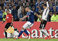 BOGOTA - COLOMBIA, 28-02-2018: Andres Cadavid (Izq) jugador de Millonarios de Colombia disputa el balón con Caique (Der) jugador de Corinthians de Brasil durante partido por la fecha 1, grupo 7, de la CONMEBOL Libertadores 2018 jugado en el estadio Nemesio Camacho El Campin de la ciudad de Bogotá. / Andres Cadavid (L) player of Millonarios of Colombia fights for the ball with Angel Romero (R) player of Corinthians of Brazil during match for the date 1, group 7, of the CONMEBOL Libertadores 2018 played at Nemesio Camacho El Campin stadium in Bogota city. Photo: VizzorImage / Gabriel Aponte / Staff.