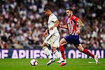 Carlos Casemiro of Real Madrid (L) in action against Saul Niguez of Atletico de Madrid (R) during their La Liga  2018-19 match between Real Madrid CF and Atletico de Madrid at Santiago Bernabeu on September 29 2018 in Madrid, Spain. Photo by Diego Souto / Power Sport Images