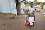 Nema Chandiru poses with her children in the Rhino Refugee Camp in northern Uganda. As of April 2017, the camp held almost 87,000 refugees from South Sudan, and more people were arriving daily. About 1.8 million people have fled South Sudan since civil war broke out there at the end of 2013. About 900,000 have sought refuge in Uganda. <br /> <br /> Chandiru's family came to Rhino from Morobo, South Sudan, in 2016.