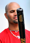 3 March 2011: St. Louis Cardinals' first baseman Albert Pujols eyes his bat prior to a Spring Training game against the Washington Nationals at Roger Dean Stadium in Jupiter, Florida. The Cardinals defeated the Nationals 7-5 in Grapefruit League action. Mandatory Credit: Ed Wolfstein Photo