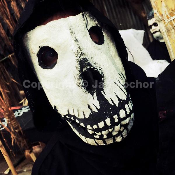 A Salvadoran boy, wearing a home made mask, takes part in an annual festivity of Día de la Calabiuza in Tonacatepeque, El Salvador, 1 November 2016.