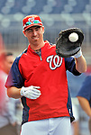 16 May 2012: Washington Nationals first baseman Adam LaRoche warms up prior to a game against the Pittsburgh Pirates at Nationals Park in Washington, DC. LaRoche notched his 1000th career hit and was named Player of the Game as the Nationals defeated the Pirates 7-4 in the first game of their 2-game series. Mandatory Credit: Ed Wolfstein Photo