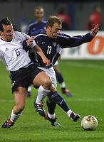 Jens Jeremies, left, Clint Mathis, right, USA vs Germany, 2002.