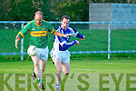 Moyvane's Cathal O'Connor solos away with the ball despite the close attention of Templenoe's Jseph Sheehy.....Ref Jim