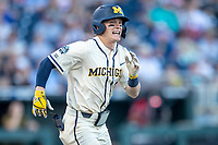 Michigan Wolverines shortstop Jack Blomgren (2) runs to first base against the Vanderbilt Commodores during Game 1 of the NCAA College World Series Finals on June 24, 2019 at TD Ameritrade Park in Omaha, Nebraska. Michigan defeated Vanderbilt 7-4. (Andrew Woolley/Four Seam Images)