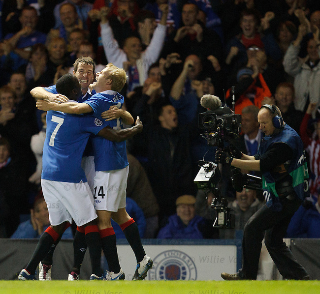 Huggy bears together as Steven Naismith is grabbed by Mo Edu and Kirk Broadfoot after scoring