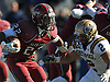 Glen Cove running back No. 22 Sharayad Letellier, left, carries the ball during a Nassau County varsity football Conference III semifinal against Bethpage at Hofstra University on Saturday, Nov. 14, 2015. Glen Cove won by a score of 21-0.<br /> <br /> James Escher