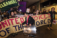 The United Voices of the World Trade union protest outside John Lewis in Oxford street over migrant cleaners being paid poverty wages. 5-11-16 The protest briefly blocked Oxford street before being moved back onto the pavement by riot cops. Extra security was deployed by John Lewis to keep them out of the store.