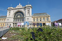 Clothes of illegal migrants dry in front of the main railway station Keleti in Budapest, Hungary on August 30, 2015. ATTILA VOLGYI