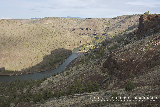 The Lower Crooked River Canyon with the North and Middle Sisters on the horizon, Oregon.