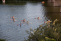 Yoga paddle boarding becomes new fitness craze as practicers meditate while maintaing their balance on a paddle board, Austin, Texas