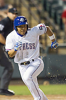 Round Rock Express designated hitter Kensuke Tanaka #8 runs to first base during the Pacific Coast League baseball game against the Memphis Redbirds on April 24, 2014 at the Dell Diamond in Round Rock, Texas. The Express defeated the Redbirds 6-2. (Andrew Woolley/Four Seam Images)