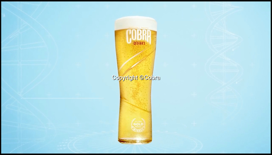 BNPS.co.uk (01202 558833)<br /> Pic: Cobra/BNPS<br /> <br /> A British brewing company has reinvented the beer glass and produced one that claims to deliver the perfect pint.<br /> <br /> The glass uses a helter skelter-like funnel that allows the beer to swirl smoothly from the tap down the surface of the inside of the glass to the bottom.<br /> <br /> In doing so it fills in a continuous spiral and creates a whirlpool effect right to the top of the glass, helping to release the aromas of the beer.