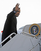 Chicago, IL - January 4, 2009 -- United States President-elect Barack Obama waves as he boards his flight to Washington, DC USA at Midway Airport in Chicago, Illinois, USA 04 January 2009. Obama will join his wife and children who are already in Washington as he prepares to take the oath of office on 20 January 2009. .Credit: Tannen Maury - Pool via CNP