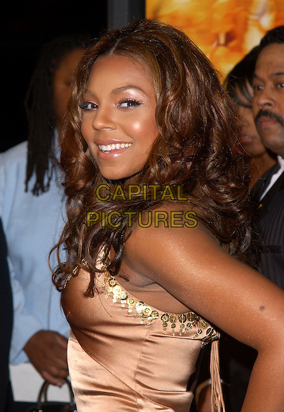 "ASHANTI & FAMILY.Paramount Pictures' L.A. Premiere of ""Coach Carter"" held at The Grauman's Chinese Theatre in Hollywood, California .January 13th, 2005 .headshot, portrait.www.capitalpictures.com.sales@capitalpictures.com.Supplied By Capital PIctures"