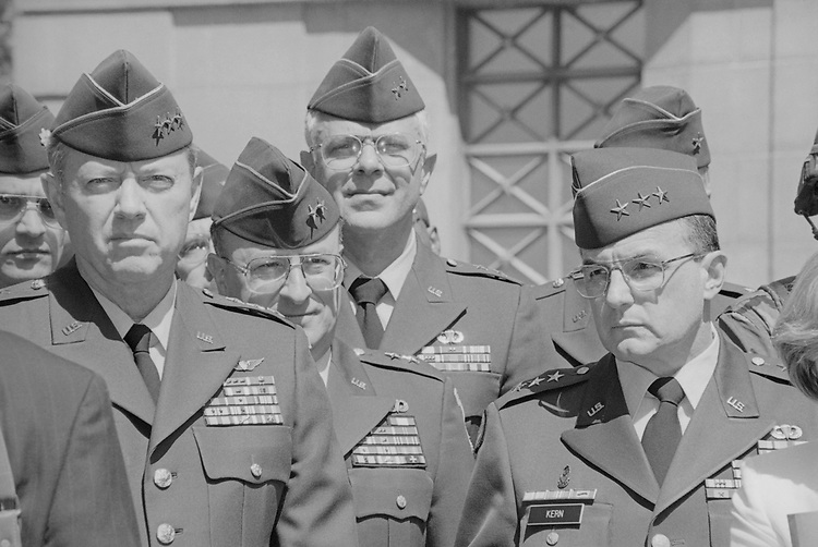 Army Lt. Gen. David K. Heebner, General Paul J. Kern, and other army members during a defense press briefing in April 1998. (Photo by Rebecca Roth/CQ Roll Call via Getty Images)
