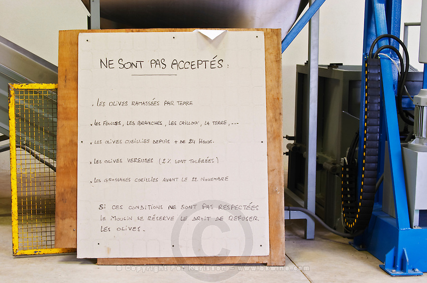 In the olive factory, a sign with instruction for hygiene and quality control. Moulin Mas des Barres olive mill, Maussanes les Alpilles, Bouches du Rhone, Provence, France, Europe
