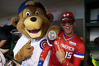 Chicago Cubs mascot with Bobby Witt, Jr. (15) of Colleyville Heritage High School in Colleyville, Texas during the Under Armour All-American Game presented by Baseball Factory on July 29, 2017 at Wrigley Field in Chicago, Illinois.  (Jon Durr/Four Seam Images)
