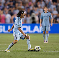 Roger Espinoza. Sporting Kansas City won the Lamar Hunt U.S. Open Cup on penalty kicks after tying the Seattle Sounders in overtime at Livestrong Sporting Park in Kansas City, Kansas.
