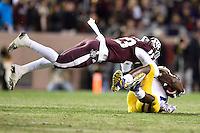 Texas A&M defensive back Armani Watts (23) brings down LSU running back Leonard Fournette (7) during an NCAA football game, Thursday, November 27, 2014 in College Station, Tex. (Mo Khursheed/TFV Media via AP Images)