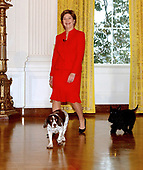 First lady Laura Bush enters the East Room of the White House in Washington, DC with the Bush Family dogs Spot and Scotty to speak about the Christmas decorations on December 5, 2002.<br /> Credit: Ron Sachs / CNP