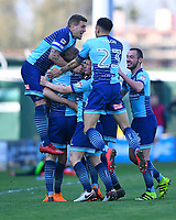 Wycombe Wanderers goalscorer Randell Williams is mobbed  during Yeovil Town vs Wycombe Wanderers, Sky Bet EFL League 2 Football at Huish Park on 14th April 2018