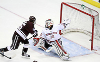 Colgate's Joe Wilson fires the puck past Nebraska Omaha goalie John Faulkner to put the Raiders up 4-3. (Photo by Michelle Bishop)