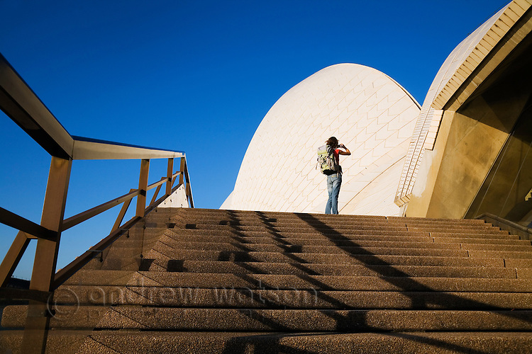 A tourist photographs the Opera House.  Sydney, New South Wales, AUSTRALIA.