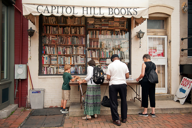UNITED STATES - JUNE 15: Browsers check out the inventory at Capitol Hill Books on C Street, SE, June 15, 2015. (Photo By Tom Williams/CQ Roll Call)