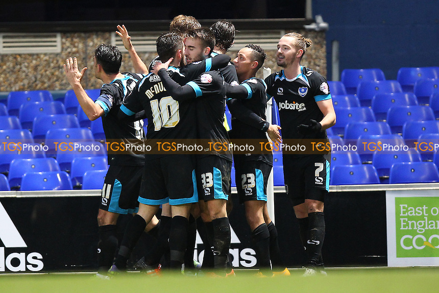 Kyle Bennett of Portsmouth (23) scores the first goal for his team and celebrates with his team mates during Ipswich Town vs Portsmouth at Portman Road