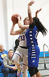 SEYMOUR CT. - 17 January 2020-011720SV10-#33 Kilay Derzek of Seymour High looks to pass as #23 Tiahana Pulliam of Crosby High defends during basketball action in Seymour Friday.<br /> Steven Valenti Republican-American