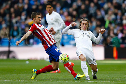 27.02.2016. Madrid, Spain.  Grabiel Fenandez Arenas (14) Atletico de Madrid and Luka Modric (19) Real Madrid during La Liga match between Real Madrid and Atletico de Madrid at the Santiago Bernabeu stadium in Madrid, Spain